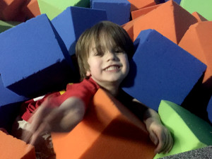 Buried in foam blocks at Flight Trampoline Park The Joy Troupe NOVA